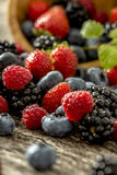 Raspberries, strawberries, blackberries and blueberries scatteri Royalty Free Stock Photography