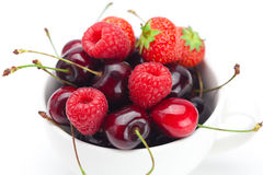 Raspberries, strawberries and cherries in a bowl Royalty Free Stock Photography