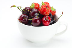 Raspberries, strawberries and cherries in a bowl Royalty Free Stock Photo