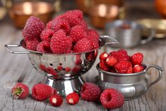 Raspberries and strawberries. Royalty Free Stock Photography