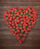 Raspberries and strawberries forming a heart shape Royalty Free Stock Photo