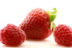 Raspberries and strawberry Royalty Free Stock Images