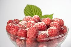 Raspberries & Sugar. Bowl of fresh raspberries sprinkled with sugar Stock Photo
