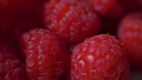 Raspberries super close up 4K stock footage. Raspberries in macro close up with a sliding camera move. Concept: footage stock video