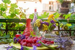 Raspberries on a table with flowers Royalty Free Stock Image