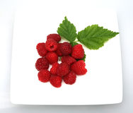 Raspberries for tea. A plate of raspberries for tea stock photo