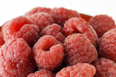 Raspberries up close. Macro with all the details of plumb ripe delicious and healthy raspberries royalty free stock photos