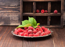 Raspberries in a vintage plate Royalty Free Stock Photography