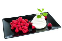 Raspberries with whipped cream. Is a delicate dessert Stock Photography