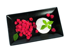 Raspberries with whipped cream. Is a delicate dessert Royalty Free Stock Photography