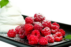 Raspberries with whipped cream. Is a delicate dessert Stock Image