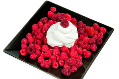 Raspberries with whipped cream. Is a delicate dessert Stock Images