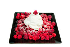 Raspberries with whipped cream. Is a delicate dessert Stock Photos