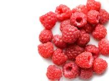 Raspberries on white. Tasty raspberries on white background Royalty Free Stock Image
