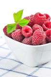 Raspberries in a white bowl. On a napkin in a lattice Stock Image