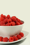 Raspberries on white bowl Royalty Free Stock Images