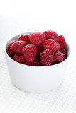 Raspberries in white bowl - close-up Stock Images