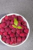 Raspberries in a white bowl Stock Photos