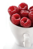 Raspberries in white cup - close-up Stock Photo