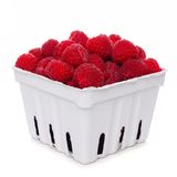 Raspberries in a white paper carton isolated on white. Fresh raspberries in a white paper carton isolated on a white background Stock Image