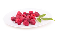 Raspberries on a white plate Royalty Free Stock Image