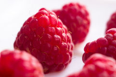 Raspberries on a white saucer close up. Big fresh juicy raspberries on a white saucer close up, selected focus Royalty Free Stock Photography