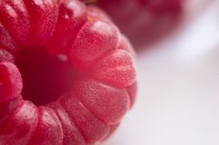 Raspberries on a white saucer close up, macro photo. Big fresh juicy raspberries on a white saucer close up, macro photo, selected focus Royalty Free Stock Photography