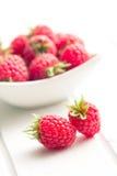 Raspberries on white table. The raspberries on white table Stock Photos