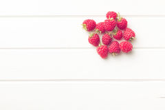 Raspberries on white table. Top view of raspberries on white table Royalty Free Stock Images