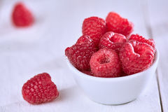 Raspberries on white table. Raspberries on a white wooden table Stock Photos