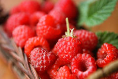 Raspberries in a wicker basket. The health benefits of vitamins and immunity Stock Photos