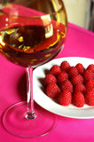 Raspberries and wine Royalty Free Stock Image
