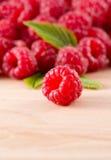 Raspberries on wood Royalty Free Stock Image
