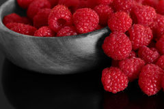 Raspberries in a wood bowl Stock Photography