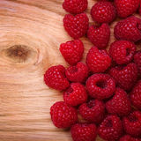 Raspberries on Wooden Background. Stock Photos