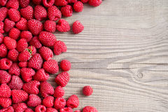 Raspberries on wooden background. Royalty Free Stock Photos