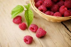 Raspberries on wooden background. Fresh raspberries on wooden background Stock Photography