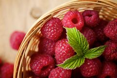 Raspberries on wooden background. Fresh raspberries on wooden background Stock Photo
