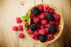 Raspberries on wooden background. Fresh raspberries on wooden background Royalty Free Stock Photo