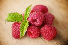 Raspberries on wooden background. Fresh raspberries on wooden background Royalty Free Stock Photography