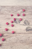 Raspberries on a wooden background. Vintage tinted, filter. Copy space Stock Photos