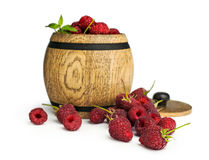 Raspberries in a wooden barrel Royalty Free Stock Photos