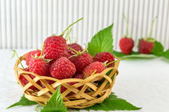 Raspberries in wooden basket Stock Photo