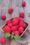Raspberries in wooden bowl. Fresh raspberries in wooden bowl Royalty Free Stock Photography