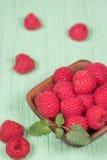 Raspberries in wooden bowl. Fresh raspberries in wooden bowl Royalty Free Stock Images