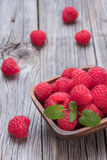 Raspberries in wooden bowl. Fresh raspberries in wooden bowl Royalty Free Stock Image