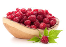 Raspberries in wooden bowl. Isolated on white background cutout Royalty Free Stock Image