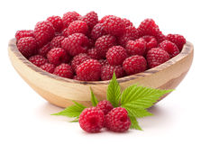 Raspberries in wooden bowl. Isolated on white background cutout Royalty Free Stock Images