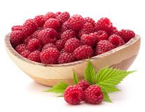Raspberries in wooden bowl Stock Images