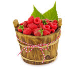 Raspberries in wooden bowl isolated on white background. Ripe and tasty berry with leaves Stock Images